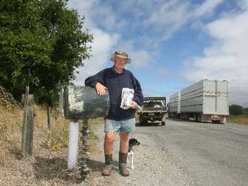 Kopuaranga farmer Roddy McKenzie with one days mail ahead of the three day rural delivery. Dog Millie.