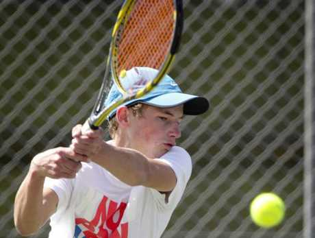 MAXIMUM POWER: Max Brewster plays a two-handed backhanded return during Hawke's Bay's premier men's interclub tennis final on Saturday.