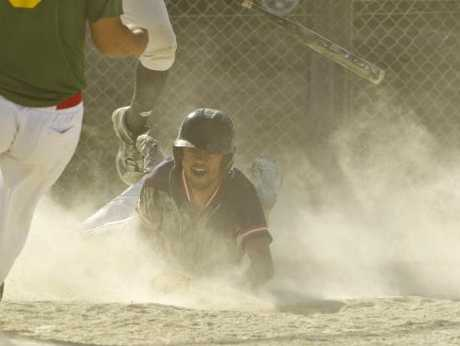 SAFE HOME: Fast Pitch runner Curtis Huata dives into home plate after stealing two bases for the first run in Saturday&#39;s final.