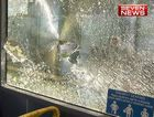 QUEENSLAND police officers were forced to drag two injured colleagues into a Brisbane council bus after they were attacked with bricks during an out-of-control party in the city's south.