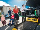 Layla, Mark and Daniel Bennington, Jessica Price are shown the ups and downs of a gifted former Maxi Taxi with lift, by Peter Creenaune from Coffs harbour & Port Maquarie Taxis. Photo: Rob Wright / The Coffs Coast Advocate
