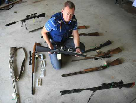 Tim Bonner, Tauranga constable, with the firearms seized after his investigation into a widespread poaching ring.
