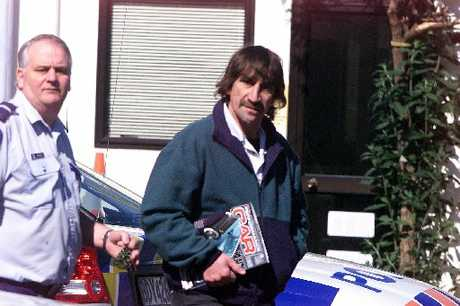 FLASHBACK: Gavin Hawthorn on his way to court in 2003, clutching a car magazine.