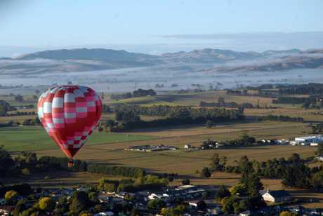 MORNING MIST: A view of Hamilton-based pilot John Clulow&#39;s balloon over the misty morning skies in Carterton.PHOTO/ TREVOR QUINN
