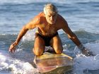 AUSTRALIAN Surf Life Saving icon Alan Coates has died of a massive heart attack while on an early morning training paddle with fellow Noosa SLSC members.