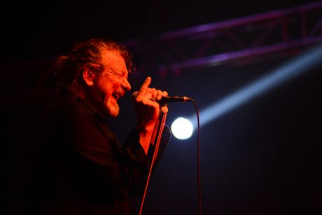 Robert Plant singing for a packed house at the Mojo tent.