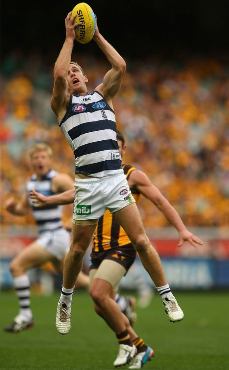 Joel Selwood of the Cats marks during the round one AFL match between the Hawthorn Hawks and the Geelong Cats at the Melbourne Cricket Ground on April 1, 2013 in Melbourne, Australia.