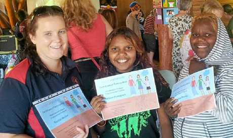 YOUNG ACHIEVER: Rachael Muller (left) with two of her students who completed subjects towards their year 11/12 leaving certificates at Imanpa College.