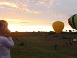 Emma Beaumont looks on as the hot air balloons take to the sky over Tauhara Park.