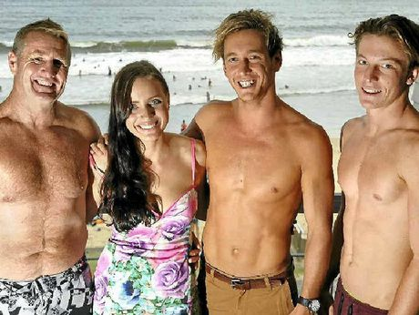CHESTY BONDING: Mooloolaba Surf Girl Brianna Heaney with (from left) Buck Rogers (sold for $50), Ali Day (sold for $265) and Harrison Kerr (sold for $50).