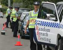 Traffic police conduct random breath testing.