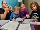ORGANISE: Registered nurse Kobi Haddow, with children Zane, Jade and Ethan, can't live without her smart phone's shift worker app.