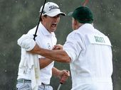 Adam Scott celebrates his historic win with his caddie. Source: Ch 7/Twitter