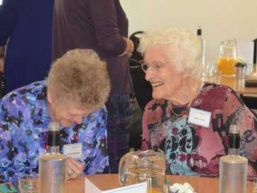 Jean Gooch (right) and Elvena McQueen share some memories.