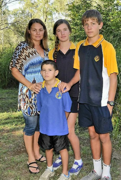 Rebecca Taylor, second from left, with, from left, Grace, 15, Matthew, 8, and Jack, 13.