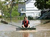 Depot Hill resident Heather Wisley makes her way along Bolsover Street in Depot Hill during the recent floods.