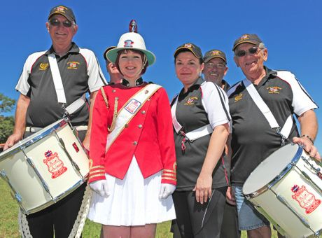 All ready for the Big Smoke; Bundaberg Drum Corps members Rex Webb-Pullman, Ian Waters, Liz Lye and Melita McIntyre, Trevor Ballantine and Tony Ravenhill are looking forward to representing Bundaberg in the Anzac Day Parade in Brisbane. Photo: Simon Young / NewsMail