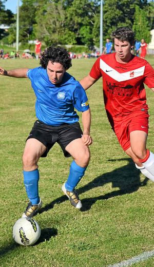 TIGHT TUSSLE: Bangalow Bluedogs' Victor Pires (left) and Jonty Miller, of Lismore Workers, clash during Football FNC action on Saturday. The Bluedogs secured a surprise 1-0 win.