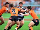 Seagulls stand-in Dave Taylor shows the Easts Tigers that taking him down is no easy feat.