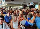 MORE than 400 people crowded the Noosa heads Surf club to celebrate the life of Alan Coates.