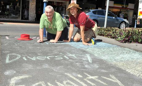 CHALKING IT UP: Ray Parry and Petr Lehner draw a rainbow crossing in Lismore.