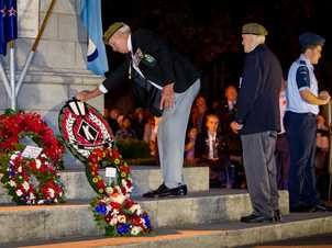 Wreaths are laid in Hastings where about 6000 people attended the dawn service.
