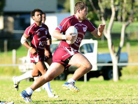 BREAKTHROUGH WIN: Fassifern coach Daniel Roos on the charge in his team's 14-8 win over Goodna a yesterday, with influential halfback Kali Nauqe in support.