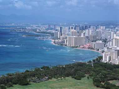 From the summit of Leahi, also known as Diamond Head, the mildly arched Waikiki Beach and Honolulu City can be seen.