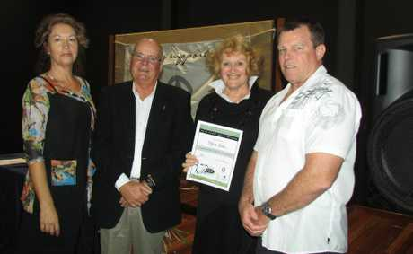 Marci Russo and David Allen of the art show organising committee, with Marie Green winner of the Judges Award presented by Bob Maher, Manager Bayer Circuit, QAL (major sponsor). At last year's Captain Cook 1770 Festival art show. Photo Contributed