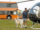 First timer for a CMCA rally Patrick Murphy and his pup Reno. Patrick stands in front of his helicopter and his bus with a heli landing pad on the roof.