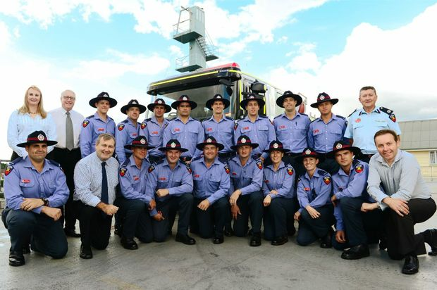 FIRED UP: Minister for Police and Community Safety Jack Dempsey (front row, second from left) welcomes 16 new firefighters to the Ipswich region.