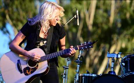 ROCKING BACK: Country music star Beccy Cole performing at Rise and Shine, the State Government's free flood recovery concert held at Rockhampton Heritage Village on the weekend.