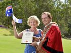 G'DAY: British-born Cathy Flach, pictured with Mayor Paul Pisasale, officially became an Australian citizen at the 18th hole at Brookwater Golf and Country Club.