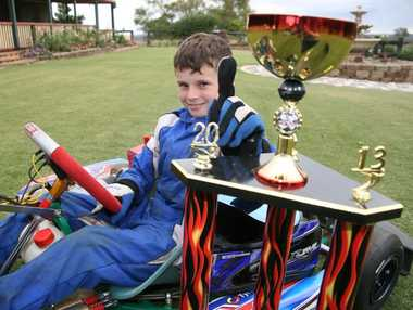 NUMBER ONE: Charlie Ploetz proudly displays his trophy for winning the Young Gun Titles go kart event in Lismore last weekend. Photo: Aiden Burgess / South Burnett Times