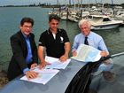 NEW MARINA: Port of Bundaberg manager Jason Pascoe, TPK Investments owner Tony Koufos and Cr Danny Rowleson look over the proposal plans of a $12 million marina development project earmarked for Burnett Heads. Photo: Max Fleet / NewsMail