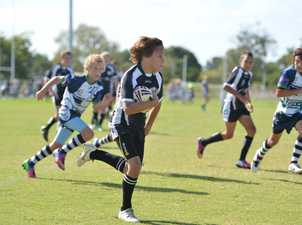 Magpies U12's Ty Stubbins sets a fast pace during the game with Brothers. Photo Lee Constable / Daily Mercury