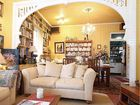 PERCHED high on a huge 2226sq m block in Woodend is this charming character home, complete with a picket fence.
