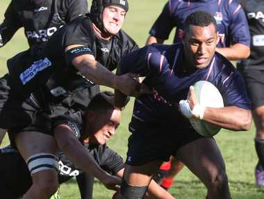 Rotoiti's Josefata Tawake breaks a tackle before scoring a try against Paroa at Emery Park on Saturday.