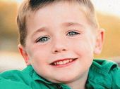 THE five-year-old boy critically injured in a school fete ride fall got on the ride without his parents even knowing, a rescue crewman has revealed.