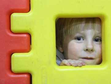 wta190513abfamilyday03.jpg 19.05.13 Maceo Field, 3, peers out from the building blocks at Wairarapa Playcentre Association's stall at the Family/Whanau Fun Day at the Genesis Recreation Centre in Masterton.