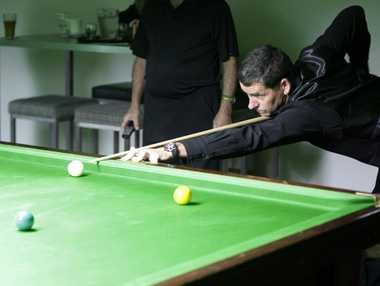 Pete Williams tries a different angle in the Bribie Over 50s Snooker Tournament. Photo Sheree Echlin / Caboolture News
