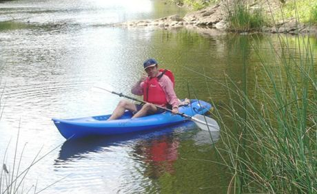 Wildlife enthusiast Greg Roberts set off in a kayak in pursuit of the Mary River crocodile.