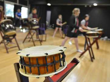 A GROUP of teachers and students from Toolooa State High are rehearsing on the Taiko drums for the upcoming QMF production of Boomtown.