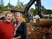 Geoff and Lexi Brown on site to watch their old pub at Uki get knocked over. 
