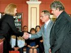 David Phillips and Neil Wildman both received bravery awards from Queensland Governor Penelope Wensley.