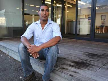 Canadian visitor Phoenix Gordon sits on a blood-stained porch at West Quay, Napier, where he was kicked on the ground as he went to the aid of another assault victim early on Sunday morning.