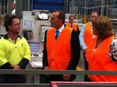 MEET AND GREET: Tony Abbott and Teresa Harding talk with an employee at Capral Aluminium.