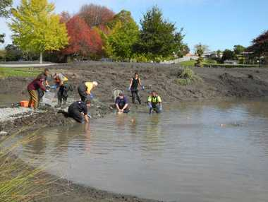 A group of Whakatane locals fish for goldfish in Sullivan Lake.