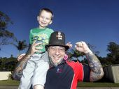Top Hat Tony helps raise the spirits of Dominick Edwards (5) with his fundraising.