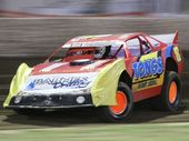 IPSWICH speedway driver Darren Kane wowed crowds at Rockhampton Showgrounds when he charged home to take out the Super Sedans feature event.